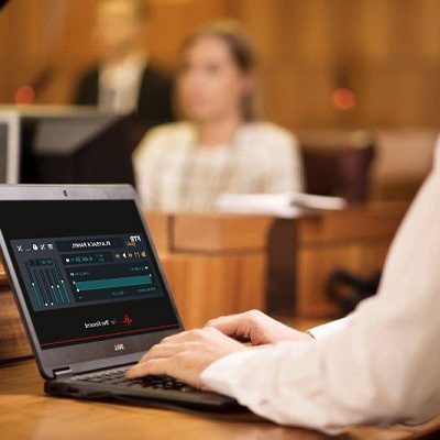 Person using FTR Player on a laptop in a courtroom
